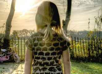 Girl alone outside staring at horizon